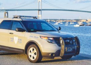 A state trooper's SUV parked at the Conanicus Avenue seawall with the Newport Pell Bridge as the backdrop. The agency that operates the bridge will have state police patrol its four spans 24/7. FACEBOOK PHOTO / RHODE ISLAND STATE POLICE