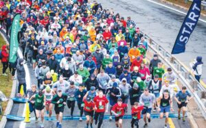 Hundreds of runners cross the starting line outside of the Rhode Island Turnpike and Bridge Authority headquarters on East Shore Road during the 2019 edition of the Citizens Pell Bridge Run. The race Sunday will be the first event since then after the 2020 edition was canceled due to the pandemic.