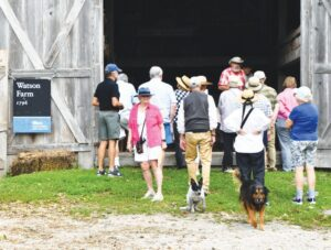Visitors explore the barn at Watson Farm during a tour in September hosted by the Jamestown Historical Society. The farm will close for the season following a fall festival Saturday.
